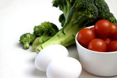 Broccoli, eggs and cherry tomatoes stock photo