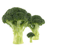 Broccoli family. 3 broccoli consisting of an abstract family image royalty free stock photos