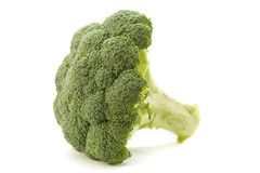 Broccoli floret. A close-up of a broccoli on white background.Broccoli is a plant in the cabbage family, whose large flower head is used as a vegetable royalty free stock photos
