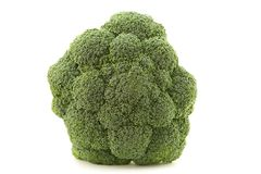 Broccoli floret. A close-up of a broccoli on white background.Broccoli is a plant in the cabbage family, whose large flower head is used as a vegetable stock photography