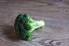 Broccoli Floret on Wood Table Stock Images