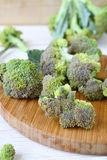 Broccoli florets on a cutting board Stock Photography