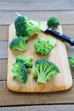 Broccoli florets on a cutting board Stock Images