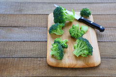 Broccoli florets on the kitchen board. Food closeup Stock Image