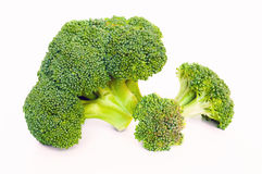 Broccoli florets on white. Selective focus Stock Image