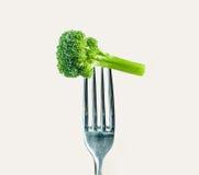 Broccoli on a fork stock photography