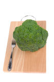 Broccoli with fork on cutting board Royalty Free Stock Photos