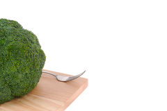 Broccoli with fork on cutting board Stock Photo