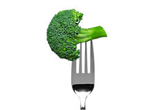 Broccoli on a fork isolated on white stock photography