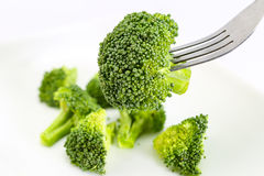 Broccoli on fork isolated on white background cutout. Healthy eating concept Stock Image