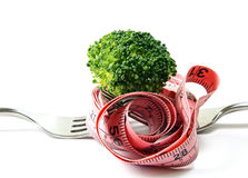 A broccoli on a fork with tape Stock Photo