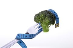 Broccoli on fork and tape measure Royalty Free Stock Image