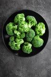 Broccoli. Fresh broccoli on plate. Top view royalty free stock image