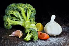 Broccoli with garlic and fresh lemon. The ingredients for the preparation of food: broccoli with garlic, and lemon Stock Photo