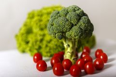 Broccoli, green lettuce and cherry tomatoes. On a table Stock Image
