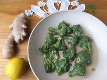 Broccoli in green nettles tempura. Fritters cooking vegetarian food with lemon and ginger stock photo