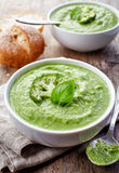 Broccoli and green peas soup Stock Images