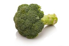 Broccoli green vegetable white isolated royalty free stock images