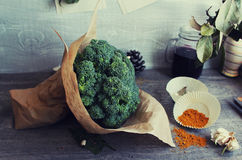 Broccoli on the grey wooden table Royalty Free Stock Images