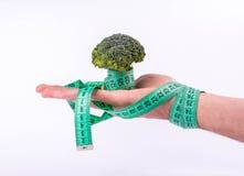 Broccoli in hand Stock Photo