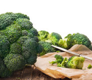 Broccoli head in crumpled paper with knife,isolated Stock Image