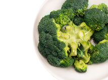 Broccoli head  in white dish, clouse up, isolated Royalty Free Stock Photo
