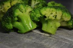 Broccoli inflorescences closeup - ingredient for cooking, vegetarian food royalty free stock photos