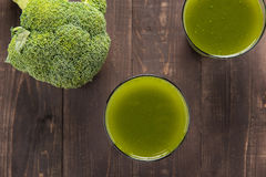 Broccoli juice on wood table. Royalty Free Stock Image