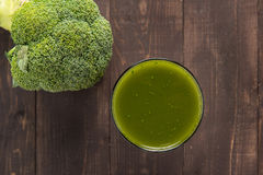 Broccoli juice on wood table. Stock Images