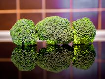 Broccoli on the kitchen table stock image