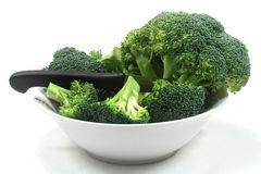 Broccoli with a knife in a white bowl Royalty Free Stock Image