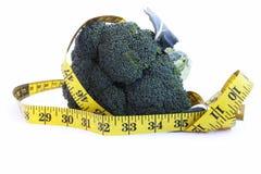 Broccoli and measurement tape Stock Image