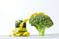 Broccoli with the measuring tape Stock Photography