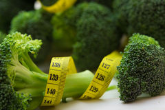 Broccoli with the measuring tape Stock Images