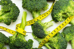 Broccoli with the measuring tape Royalty Free Stock Photos