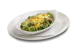 Broccoli with melted cheese on the top Royalty Free Stock Photography