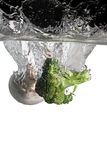 Broccoli and mushroom in water. Broccoli and mushroom falls in water royalty free stock photos