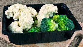 Broccoli och blomkålen boxas Fotografering för Bildbyråer
