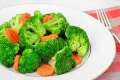 Broccoli och morötter Banta konditionnäring Royaltyfria Bilder
