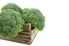 Broccoli in old wooden auction crate Stock Photos