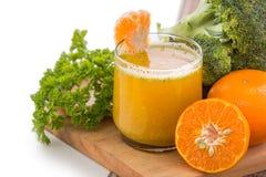 Broccoli and Orange mix juice isolated Royalty Free Stock Image