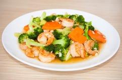 Broccoli in padella del gamberetto con la carota Fotografia Stock