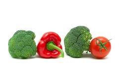 Broccoli, paprika en tomaat op een witte achtergrond Royalty-vrije Stock Fotografie