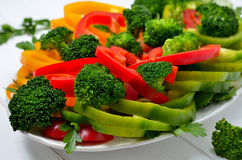 Broccoli and paprika. Mixed vegetables with paprika and broccoli on a plate Stock Images
