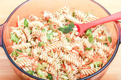 Broccoli in Pasta Salad. Broccoli, carrots and olives in a cold pasta salad Stock Photos