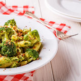 Broccoli pasta with sauce of green peas. Stock Photography