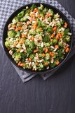 Broccoli with peanuts and carrots vertical top view Stock Image