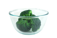 Broccoli pices in transparent bowl. Fresh broccoli pieces in transparent bowl isolated on white background Stock Photography