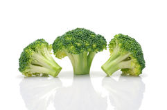 Broccoli pieces. A close up of chopped broccoli on white background Royalty Free Stock Images