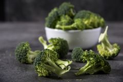 Broccoli pieces on a granite tabletop. Cooking preparation. Healthcare concept Royalty Free Stock Photo